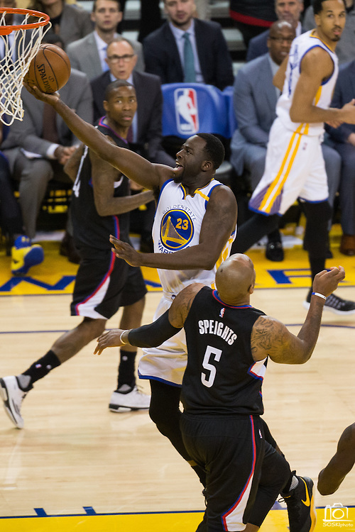 Golden State Warriors forward Draymond Green (23) takes the ball to the basket against the LA Clippers at Oracle Arena in Oakland, Calif., on February 23, 2017. (Stan Olszewski/Special to S.F. Examiner)