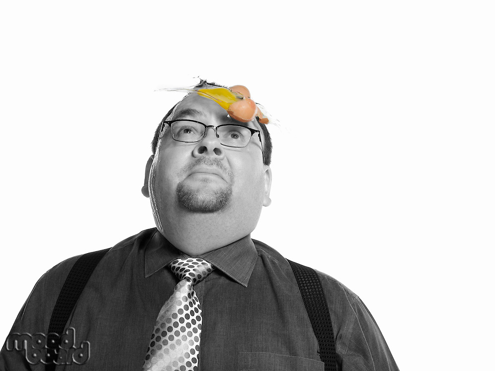 Businessman with Egg on his Face