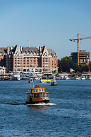 Downtown Victoria, BC, features a mix of historical and new buildings on the Inner Harbour. Harbour ferries transport people from one port to another in the Inner Harbour.