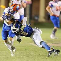 North Pontotoc's Sheffield Anthony is knocked off balance by Booneville's Davian Price in the third quarter.