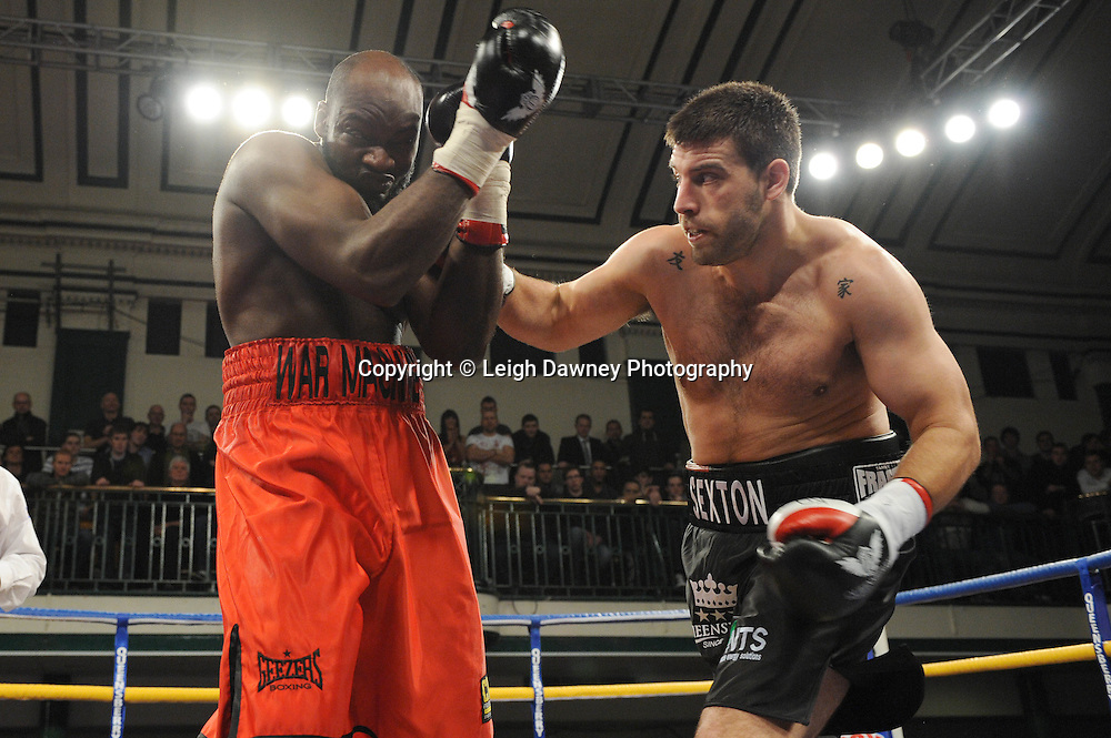 Sam Sexton (black shorts) defeats Larry Olubamiwo in a Heavyweight contest at York Hall, Bethnal Green, London on Friday 13th January 2012. Queensbury Promotions © Leigh Dawney 2012