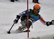 A gate is in the eyes of Tyler Walker in the sitting slalom at Whistler
