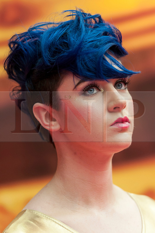 © Licensed to London News Pictures. 25/04/2016. London, UK. A model at the Pro Hair Live event at Olympia in west London.  The show brings the latest innovation in hair care to professional hairdressers and barbers.  Photo credit : Stephen Chung/LNP