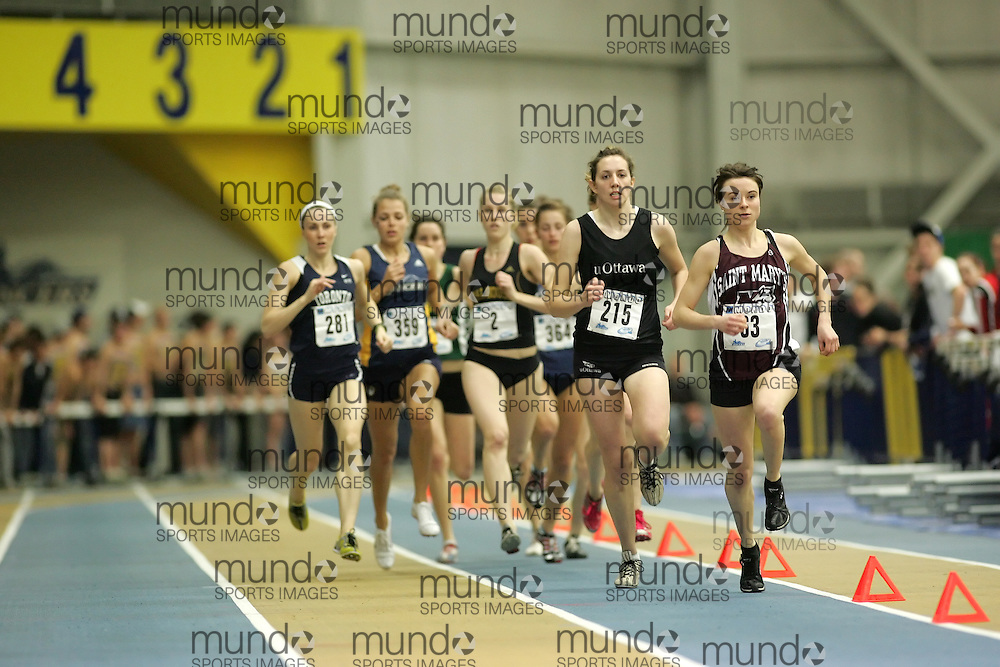 (Windsor, Ontario---12 March 2010) Julia Malleck of University of Ottawa Gee-Gees   Ashley Ryer of Saint Mary's University   competes in the 1000m final at the 2010 Canadian Interuniversity Sport Track and Field Championships at the St. Denis Center. Photograph copyright Sean Burges/Mundo Sport Images. www.mundosportimages.com
