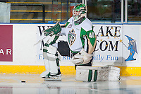 KELOWNA, CANADA - DECEMBER 6: Nick McBride #40 of Prince Albert Raiders stretches on the ice during warm up against the Kelowna Rockets on December 6, 2014 at Prospera Place in Kelowna, British Columbia, Canada.  (Photo by Marissa Baecker/Shoot the Breeze)  *** Local Caption *** Nick McBride;