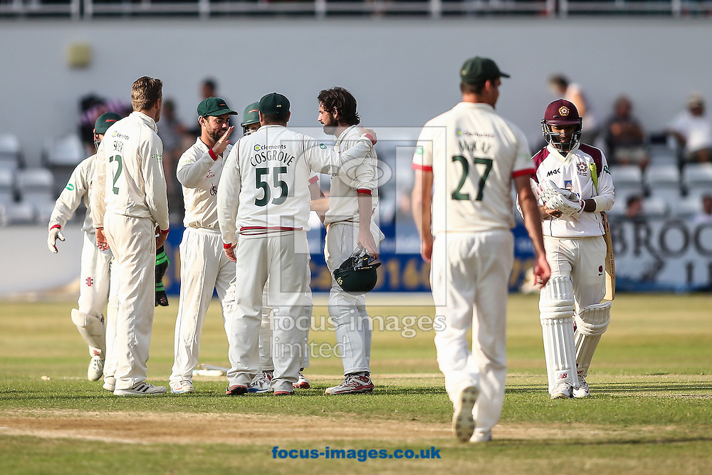 Leicestershire players celebrate taking the wicket of nightwatchman Muhammad Azhar Ullah of Northamptonshire CCC (right) during the Specsavers County C'ship Div Two match at the County Ground, Northampton<br /> Picture by Andy Kearns/Focus Images Ltd 0781 864 4264<br /> 14/08/2016