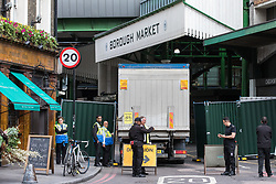 © Licensed to London News Pictures. 12/06/2017. London, UK. A delivery lorry enters Borough Market as traders begin clearing up and prepare to reopen. The market was the scene of a terrorist attack on Saturday 3 June 2017 in which eight people were killed. Photo credit: Rob Pinney/LNP