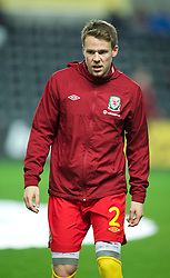 SWANSEA, WALES - Tuesday, March 26, 2013: Wales' Chris Gunter, wearing Compressport ForQuad, warms-up before the 2014 FIFA World Cup Brazil Qualifying Group A match against Croatia at the Liberty Stadium. (Pic by David Rawcliffe/Propaganda)