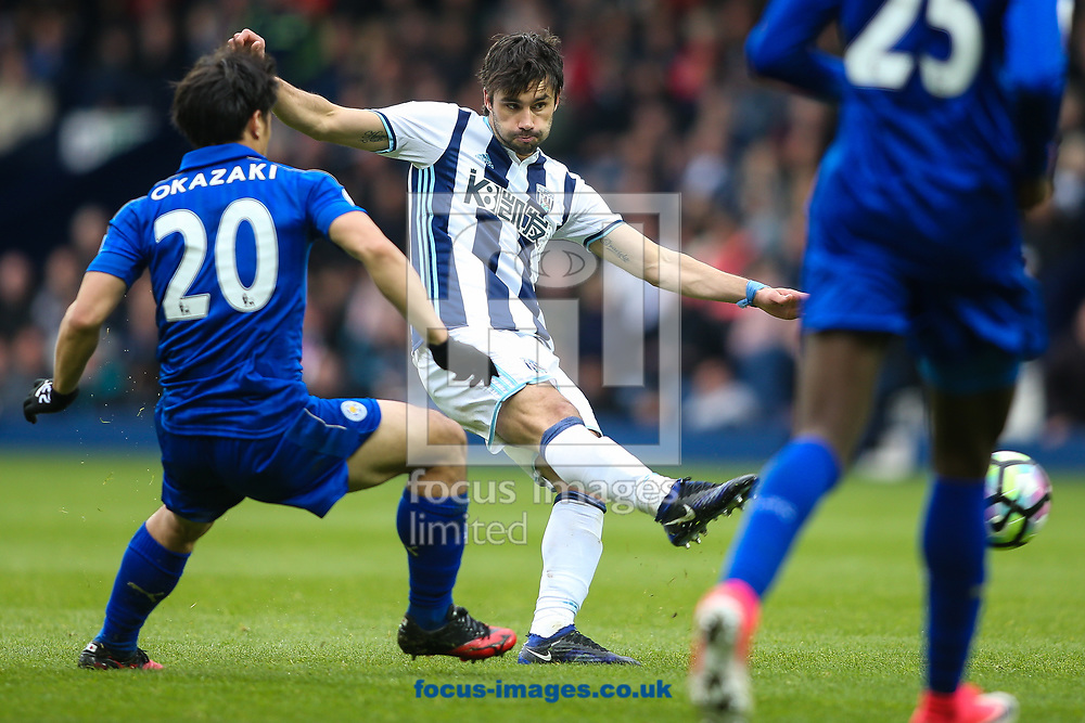 Claudio Yacob of West Bromwich Albion (centre) shoots at goal during the Premier League match at The Hawthorns, West Bromwich<br /> Picture by Andy Kearns/Focus Images Ltd 0781 864 4264<br /> 29/04/2017