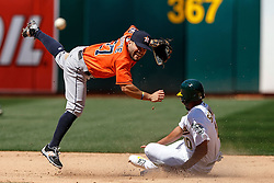 OAKLAND, CA - MAY 01: Jose Altuve #27 of the Houston Astros completes a double play over Marcus Semien #10 of the Oakland Athletics during the seventh inning at the Oakland Coliseum on May 1, 2016 in Oakland, California. The Houston Astros defeated the Oakland Athletics 2-1. (Photo by Jason O. Watson/Getty Images) *** Local Caption *** Jose Altuve; Marcus Semien