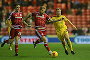 Middlesbrough midfielder Adam Clayton  tackles Burnley midfielder Scott Arfield  during the Sky Bet Championship match between Middlesbrough and Burnley at the Riverside Stadium, Middlesbrough, England on 15 December 2015. Photo by Simon Davies.