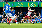 Ben Close (33) of Portsmouth battles for possession with Charlie Wyke (9) of Bradford City during the EFL Sky Bet League 1 match between Portsmouth and Bradford City at Fratton Park, Portsmouth, England on 28 October 2017. Photo by Graham Hunt.