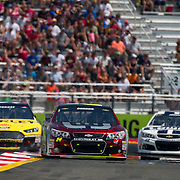 August 10, 2014:  Sprint Cup Series driver Marcos Ambrose (9) goes wide in an attempt to pass Sprint Cup Series driver Jeff Gordon (24) during the Cheez-It 355 at Watkins Glen International, Watkins Glen, NY.  Mandatory Credit: Kostas Lymperopoulos /CSM (Credit Image: © Kostas Lymperopoulos/Cal Sport Media)