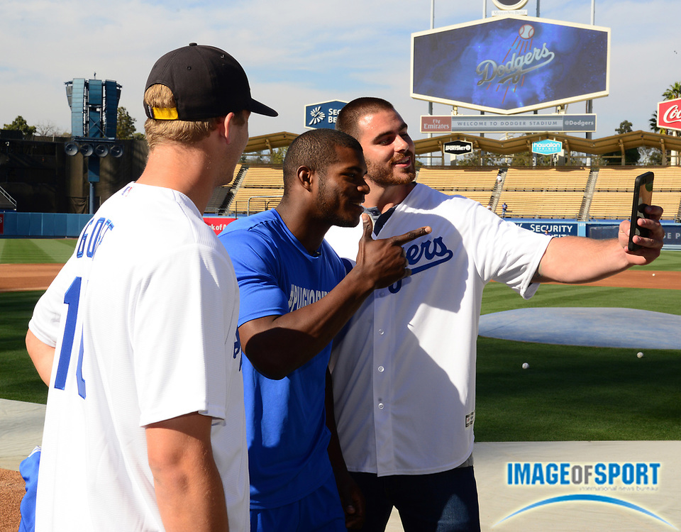 Jun 6, 2016; Los Angeles, CA, USA; Los Angeles Rams quarterback Jared Goff (left) and tight end Tyler Higbee (right) pose with Los Angeles Dodgers right fielder Yasiel Puig (center)  before a MLB game against the Colorado Rockies at Dodger Stadium.