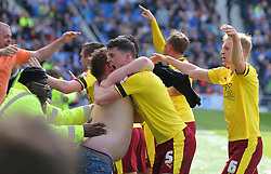 Michael Keane ( C ) of Burnley celebrates with a fan after he scores to make it 2-2 - Mandatory by-line: Paul Terry/JMP - 02/04/2016 - FOOTBALL - Amex Stadium - Brighton, England - Brighton and Hove Albion v Burnley - Sky Bet Championship