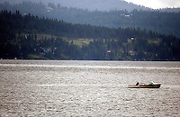 JEROME A. POLLOS/Press..A boater makes his away across Lake Coeur d'Alene as a light rain began to fall Friday afternoon.