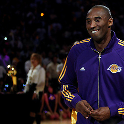 Los Angeles Lakers' Kobe Bryant smiles with ring in hand after recieving i from NBA Commissioner David Stern before a basketball game at the Staples Center on Tuesday, October 27, 2009 in Los Angeles. (SGVN/Staff Photo by Keith Birmingham/SPORTS)