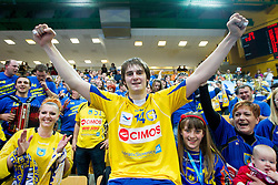 Sebastian Skube of Cimos Koper with fans celebrate after the 1st Leg handball match between RK Cimos Koper and BM Atletico Madrid (ESP) in Quarterfinals of EHF Champions League 2011/2012, on April 21, 2012 in Arena Bonifika, Koper, Slovenia.  Cimos Koper defeated Atletico Madrid 26-23. (Photo by Vid Ponikvar / Sportida.com)
