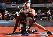 07 MARCH 2009: Coe's Tyler Burkle tries to control University of Dubuque's Josh Terrell (left) in the 165-pound quarterfinal at the 2009 NCAA Division III Wrestling Championships at the US Cellular Center in Cedar Rapids, Iowa on Friday March 7, 2009. Terrell won 5-1.