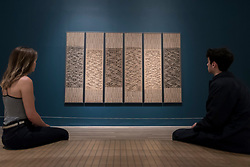"© Licensed to London News Pictures. 09/10/2018. LONDON, UK. Visitors view ""Six Prayers"", 1966-7, by Anni Albers.  Preview of the UK's first exhibition of works by German artist Anni Albers at Tate Modern who used the ancient art of hand-weaving to produce works of modern art.  Over 350 of her artworks from major collections from Europe and the US are on show 11 October to 27 January 2019.  Photo credit: Stephen Chung/LNP"