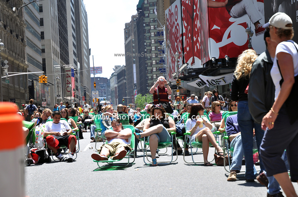USA, New York, New York City, Times Square and Broadway Pedestrian Mall, People Relaxing on Deck Chairs
