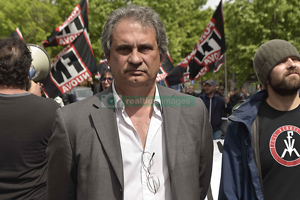 Italy, Rome - May 13, 2019.Riace suspended mayor Mimmo Lucano to talk at La Sapienza university in Rome.Far-right movement Forza Nuova militant attacks youth during an anti fascist demonstration to support Mimmo Lucano.ROBERTO FIORE and FN Forza Nuova militants demonstrate against Mimmo Lucano and his supporters (Credit Image: © Vairello-Sisto/Fotogramma/Ropi via ZUMA Press)