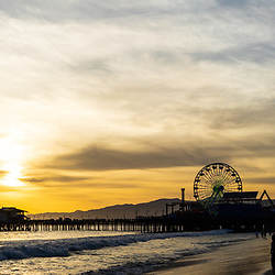 Santa Monica Pier at sunset along the Pacific Ocean in Southern California. Panorama photo ratio is 1:3. Copyright ⓒ 2017 Paul Velgos with All Rights Reserved.