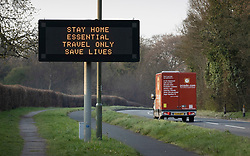 © Licensed to London News Pictures. 28/03/2020. Leatherhead, UK. An Ocado delivery van passes a roadside matrix sign displays a message saying ' STAY HOME ESSENTIAL TRAVEL ONLY SAVE LIVES'  on the A24 near Leatherhead in Surrey. The Prime Minister Boris Johnson and Health Secretary Matt Hancock have tested positive for the virus and are now self isolating. Photo credit: Peter Macdiarmid/LNP