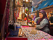 05 JULY 2011 - BANGKOK, THAILAND:  A woman from the Middle East looks at jewelry at a street stall on Soi Arab in Bangkok. Soi Arab is an alleyway in Bangkok. What started as an alley has now grown into a neighborhood that encompasses several blocks of restaurants, hotels and money exchanges that cater to Middle Eastern visitors to Thailand. The official name of the street is Sukhumvit Soi 3/1, located in North Nana between Sukhumvit Soi 3 and Sukhumvit Soi 5, not far from the Nana Plaza night-life area and the Grace Hotel popular among Arabs.   PHOTO BY JACK KURTZ