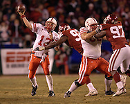 University of Nebraska Zac Taylor (13) gets the pass off under pressure from Oklahoma's Larry Birdine (92) in the second half, during the Big 12 Championship game at Arrowhead Stadium in Kansas City, Missouri, December 2, 2006.  Oklahoma beat Nebraska 21-7.<br />