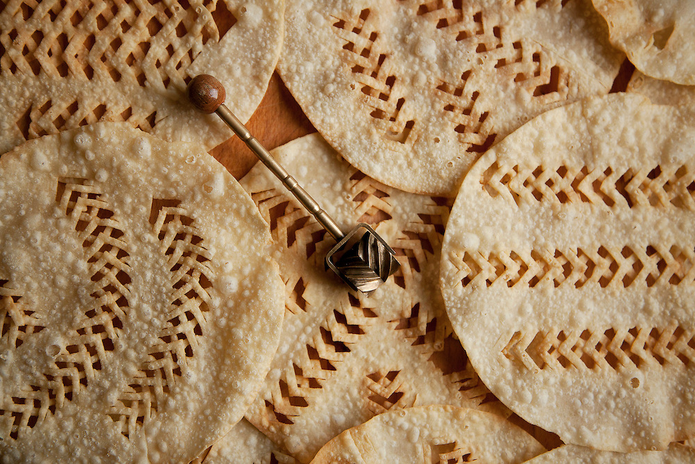 Laufabrauð or leaf bread with the special utensil used to make the distinctive patterns at Nanna Rögnvaldardóttir's home in Reykjavik, Iceland, December 2013.