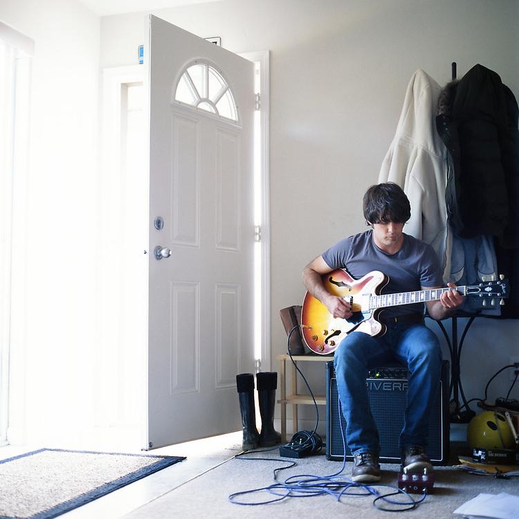 ANCHORAGE, ALASKA - 2009: Singer songwriter, Evan Phillips.