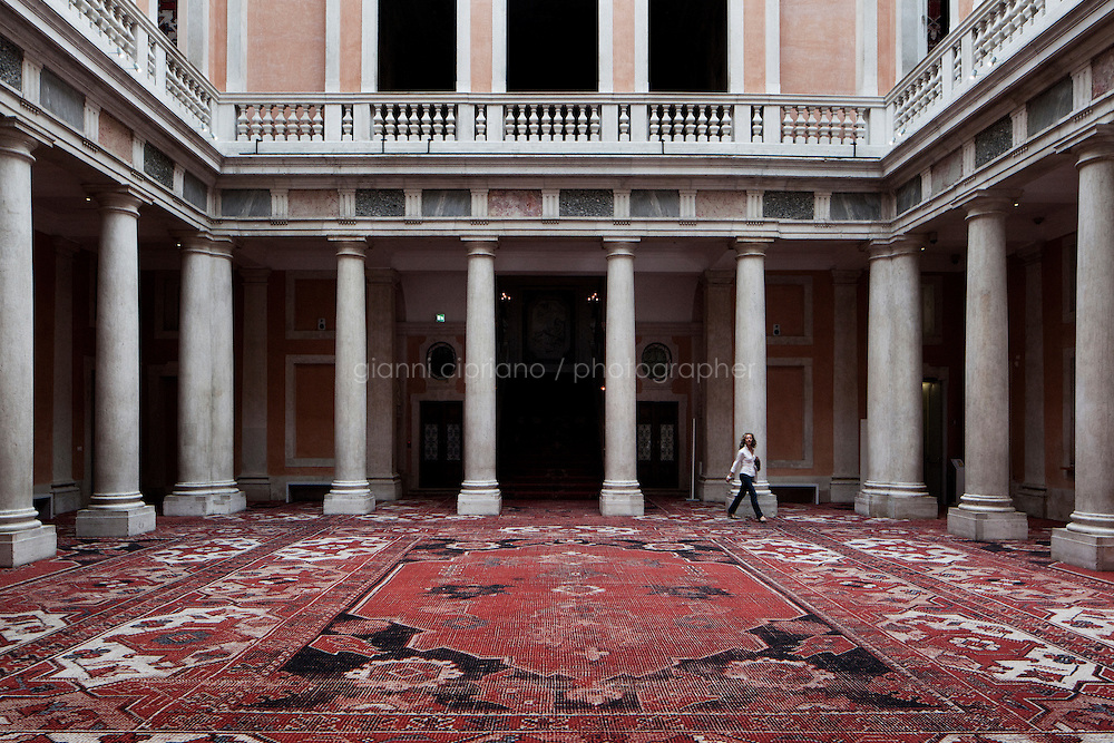 VENICE, ITALY - 28 MAY 2013: at the exhibition &quot;Rudolf Stingel&quot; at Palazzo Grassi in Venice, Italy, on May 28th 20113. <br /> <br /> The exhibition &quot;Rudolf Stingel&quot; unfolds over the atrium and both upper floors of Palazzo Grassi, a space of over 5,000 square meters. For the first time, Palazzo Grassi devotes the entirety of its space to the work of a single artist. It includes a site-specific installation as well as recent creations and previously unseen paintings. This is Stingel's largest ever monographic presentation in Europe and his first solo exhibition in an Italian museum since his mid-career retrospective at MART in 2001.<br /> <br /> The project, conceived by the artist expressly for Palazzo Grassi, spreads over all the rooms of the building, where a carpet with oriental patterns covers, for the first time, the entire surface of the walls and floors. The installation is part of Stingel's artistic research, which has always been directed towards the analysis of the relationship between the exhibition space and artistic intervention: for the artist, the carpet is a medium through which painting relates to its architectural context.<br /> <br /> The 55th International Art Exhibition of the Venice Biennale takes place in Venice from June 1st to November 24th, 2013 at the Giardini and at the Arsenale as well as in various venues the city. <br /> <br /> Gianni Cipriano for The New York TImes