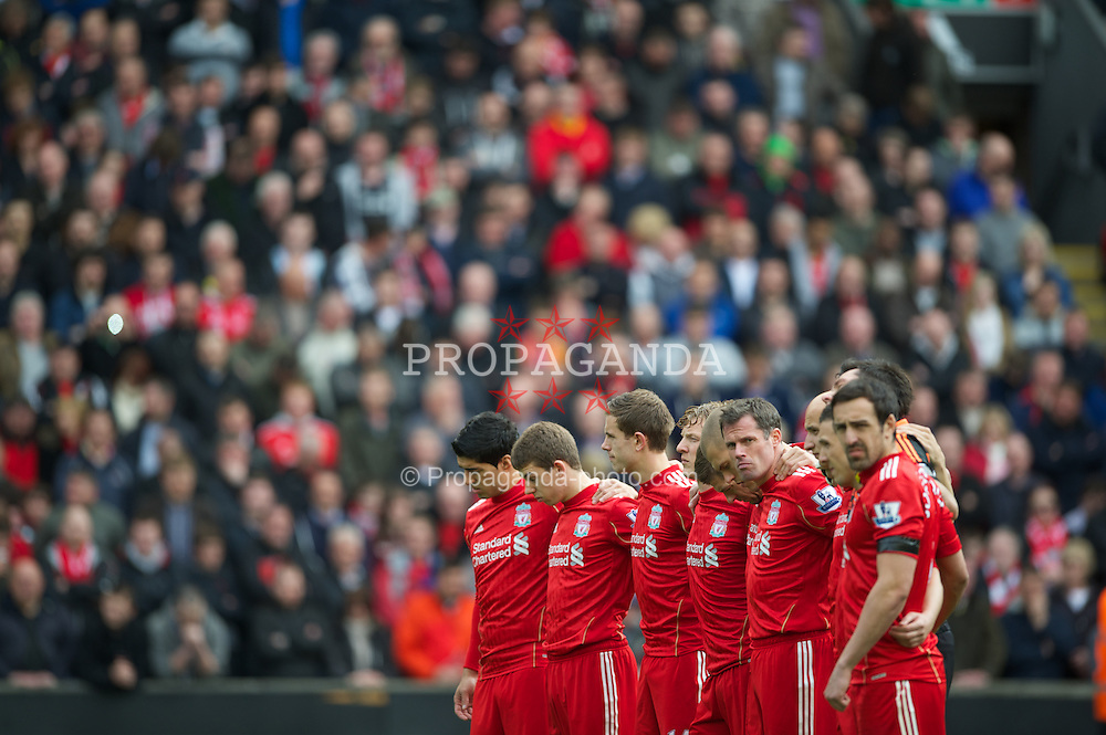 LIVERPOOL, ENGLAND - Saturday, April 7, 2012: Liverpool players stand for a minute's silence to remember the 96 victims of the 1989 Hillsborough Stadium Disaster before the Premiership match against Aston Villa at Anfield. (Pic by David Rawcliffe/Propaganda)