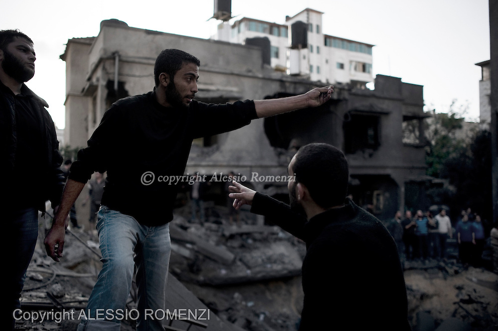 Gaza City: A Palestinian man prevent people to enter the area bombed by Israeli Airforce. November 18, 2012. ALESSIO ROMENZI