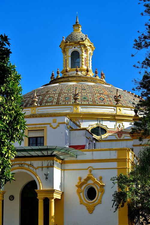 Lope de Vega Theatre in Mar&iacute;a Luisa Park in Seville, Spain<br /> Architect Vicente Traver y Tom&aacute;s integrated a theater and casino into the Pabell&oacute;n de Sevilla for Expo Sevilla 1929. This Brogue fa&ccedil;ade crowned with a ceramic dome was the casino entrance from Mar&iacute;a Luisa Park. After a checkered past of physical disasters and renovations, Lope de Vega Theatre is now a venue for concerts and plays. The theater&rsquo;s namesake was one of Spain&rsquo;s most prolific and famous playwrights who lived from 1562 until 1635.