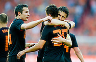 In action for   Robin van Persie , Ibrahim Afellay and Mark van Bommel celebrate the first goal  The Netherlands versus    Slovakia during friendly soccer match between Netherlands vs Slovakia in Rotterdam on May 30, 2012. AFP PHOTO/ ROBIN UTRECHT