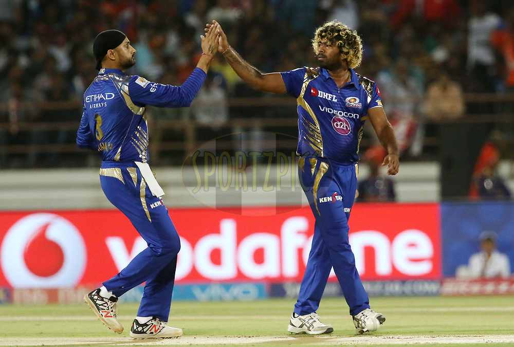 Harbhajan Singh of the Mumbai Indians and Lasith Malinga of the Mumbai Indians celebrates the wicket of Brendon McCullum of the Gujarat Lions during match 35 of the Vivo 2017 Indian Premier League between the Gujarat Lions and the Mumbai Indians  held at the Saurashtra Cricket Association Stadium in Rajkot, India on the 29th April 2017<br /> <br /> Photo by Vipin Pawar - Sportzpics - IPL