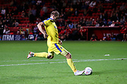 AFC Wimbledon striker James Hanson (18) scoring the winning penalty during the EFL Trophy match between Charlton Athletic and AFC Wimbledon at The Valley, London, England on 4 September 2018.