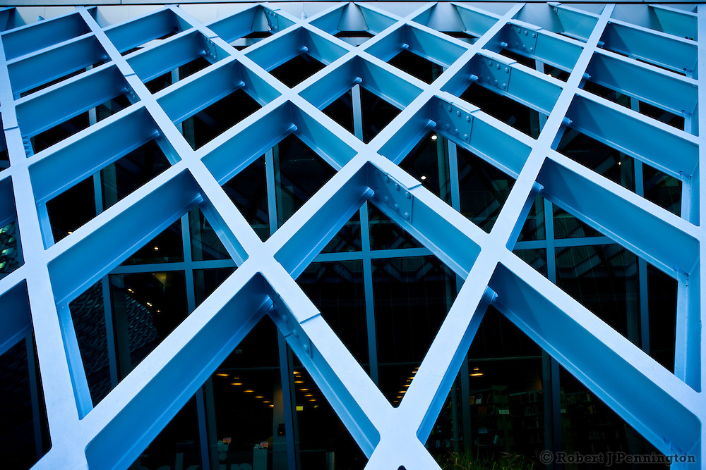 The criss cross pattern of an architectural structure in a contemporary building.
