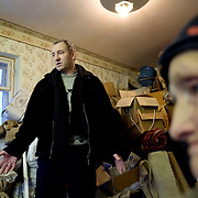 Nina Merzlikina, 75, and Sergei Kostenko, 45, have packed up their belongings at this apartment in Yor Shor village in expectation of eviction by bailiffs. Local officials want to close the village, near Vorkuta town, so they can shut off supplies of gas and electricity..Vorkuta is a coal mining and former Gulag town 1,200 miles north east of Moscow, beyond the Arctic Circle, where temperatures in winter drop to -50C. .Here, whole villages are being slowly deserted and reclaimed by snow, while the financial crisis is squeezing coal mining companies that already struggle to find workers..Moscow says its Far North is a strategic region, targeting huge investment to exploit its oil and gas resources. But there is a paradox: the Far North is actually dying. Every year thousands of people from towns and cities in the Russian Arctic are fleeing south. The system of subsidies that propped up Siberia and the Arctic in the Soviet times has crumbled. Now there?s no advantage to living in the Far North - salaries are no higher than in central Russia and prices for goods are higher.