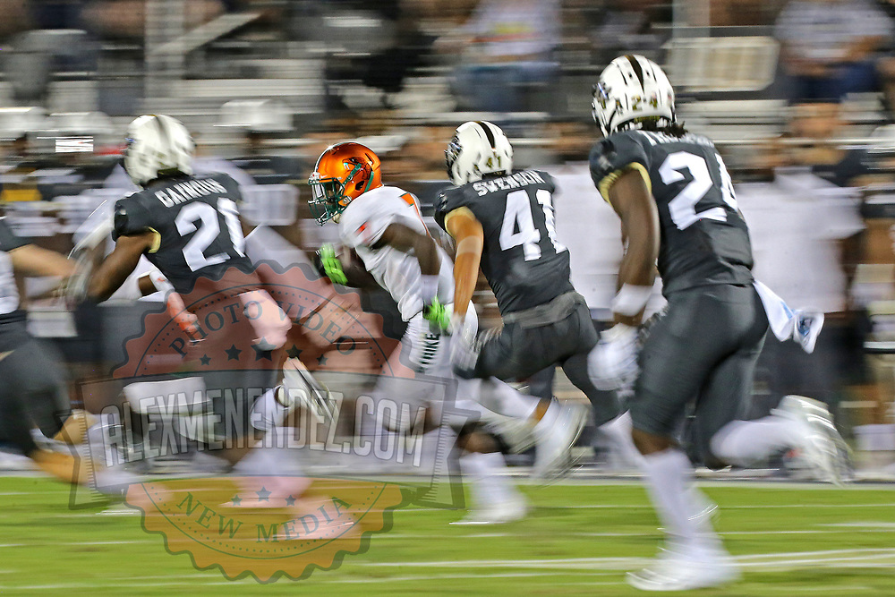 ORLANDO, FL - AUGUST 29: George Webb #7 of the Florida A&M Rattlers returns a kick against Derek Gainous #21, Alex Swenson #41 and Bentavious Thompson #24 of the UCF Knights during a NCAA football game on August 29 2019 in Orlando, Florida. (Photo by Alex Menendez/Getty Images) *** Local Caption *** George Webb; Derek Gainous; Alex Swenson; Bentavious Thompson