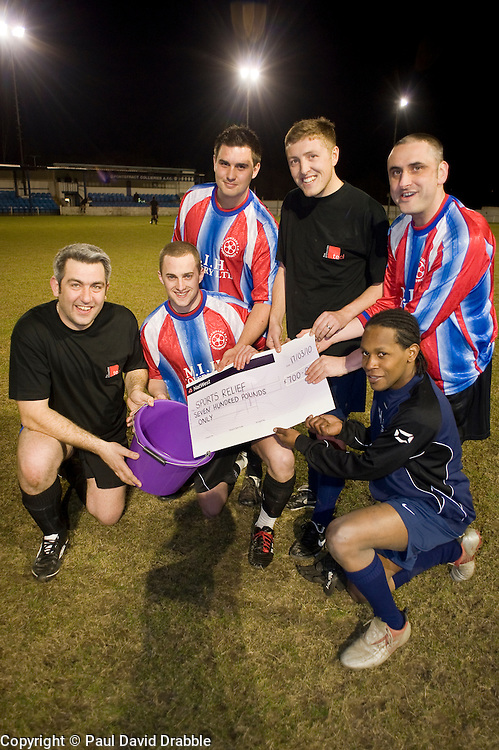 Chris Blackwell Natwest Business Banking Manger at the Dewsbury branch and organizer of the charity football match in Aid of Sport Relief with TECL team Captain Mark Humphrey at the Pontifract Collieries FC ground