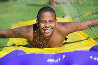 """Boy Sliding on """"Slip 'N Slide"""""""