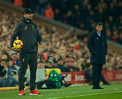 LIVERPOOL, ENGLAND - Wednesday, February 27, 2019: Liverpool's manager Jürgen Klopp stands holding the ball during the FA Premier League match between Liverpool FC and Watford FC at Anfield. (Pic by Paul Greenwood/Propaganda)