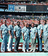 (L-R) Former players San Francisco 49ers tackle Bob St. Clair, Pittsburgh Steelers linebacker Jack Lambert, Pittsburgh Steelers  running back Franco Harris, Dallas Cowboys head coach Tom Landry, Miami Dolphins quarterback Bob Griese, Oakland / Los Angeles Raiders linebacker Ted Hendricks, and Kansas City Chiefs defensive tackle Buck Buchanan pose for a photo after being recently announced members of the latest Pro Football Hall of Fame class of 1990 at halftime during the 1990 NFL Pro Bowl between the National Football Conference and the American Football Conference on Feb. 4, 1990 in Honolulu. The NFC won the game 27-21. (©Paul Anthony Spinelli)