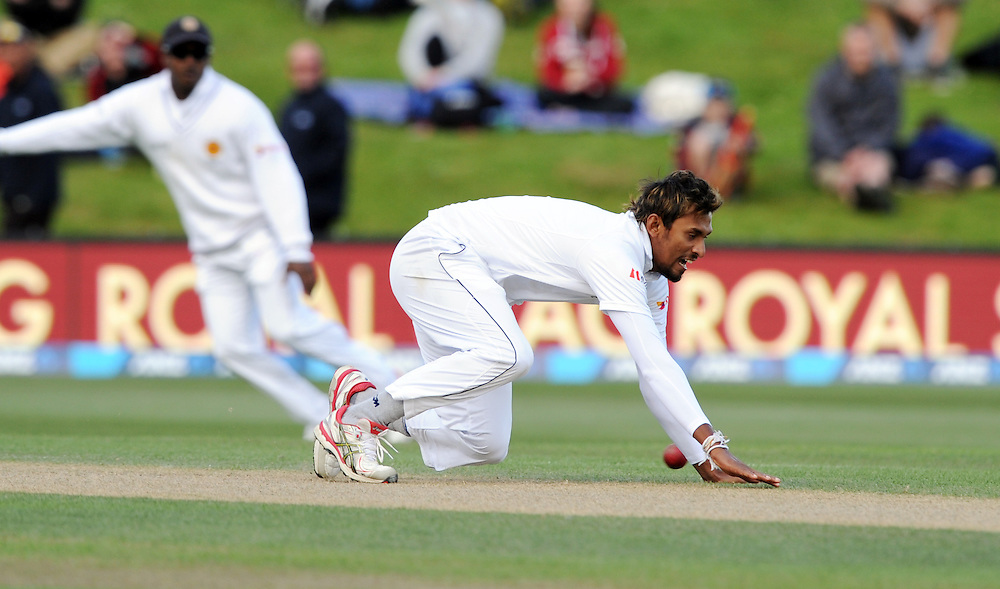 Sri Lanka's Suranga Lakmal attempts to field off his own bowling against New Zealand on day four of the first International Cricket Test, University Cricket Oval, Dunedin, New Zealand, Sunday, December 13, 2015.Credit:SNPA / Ross Setford