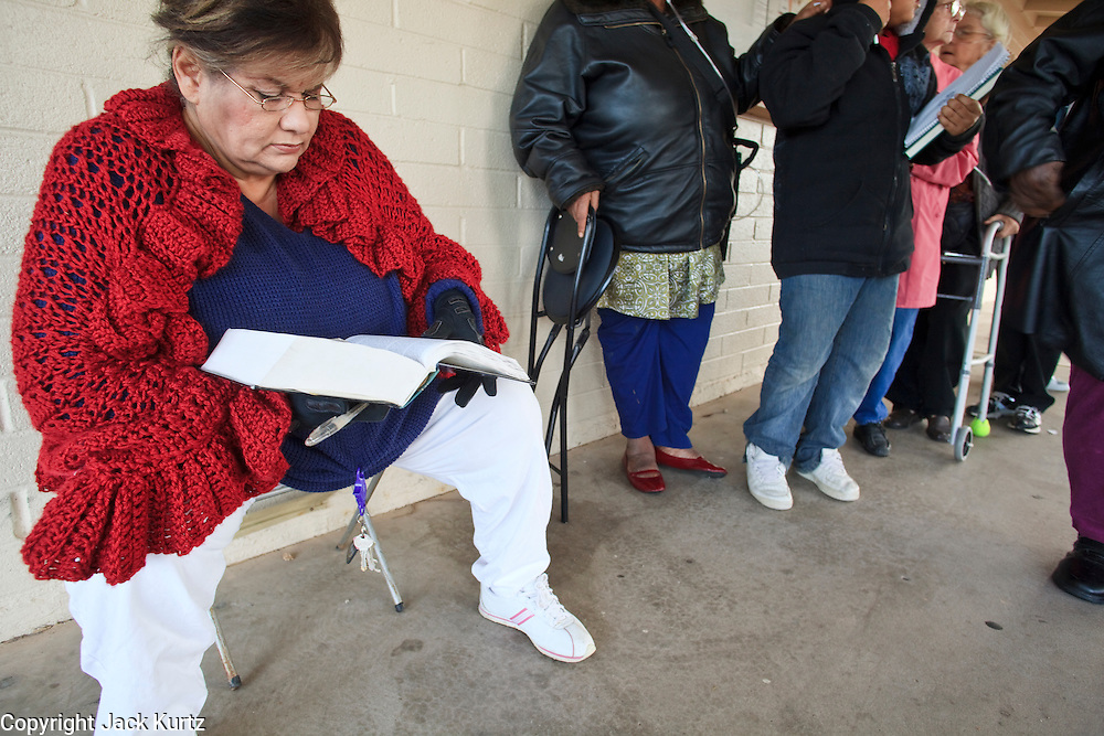 23 DECEMBER 2008 -- CHANDLER, AZ: Susan Urbana (CQ) studies her bible while waiting for the food bank to open at the Chandler Christian Community Center in Chandler Tuesday.   PHOTO BY JACK KURTZ