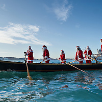 VENICE, ITALY - DECEMBER 26: Rowers dressed as Father Christmas escort a gondola ferrying a live nativity scene from St Mark's to the Island of S Giorgio on December 26, 2011 in Venice, Italy.  The event is in its first year wants and to replicate an ancient tradition when the Doge of Venice used to go to the Island of S Giorgio to celebrate the relics of Santo Stefano on Boxing Day. HOW TO LICENCE THIS PICTURE: please contact us via e-mail at sales@xianpix.com or call our office London   +44 (0)207 1939846 for prices and terms of copyright. First Use Only ,Editorial Use Only, All repros payable, No Archiving.© MARCO SECCHI