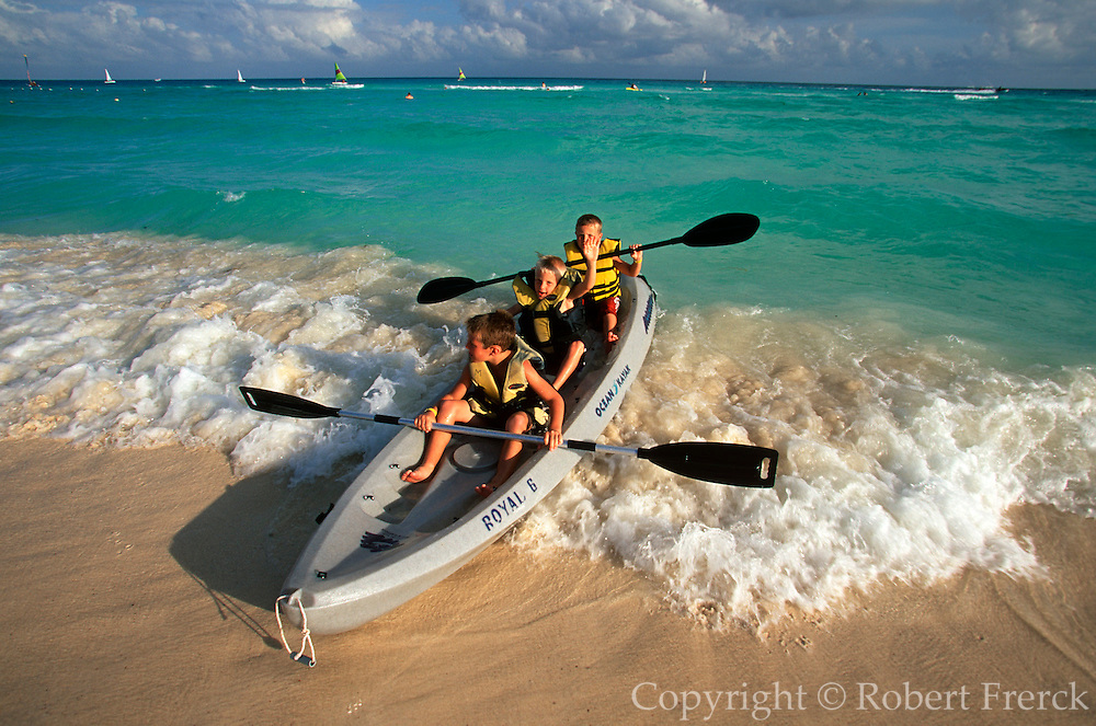 MEXICO, YUCATAN, TOURISM Riviera Maya; kids in the surf